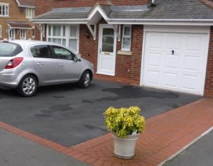 Block paving used to complement a tarmacadam driveway