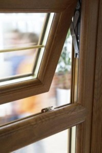 PVCu replacement windows with oak effect frames