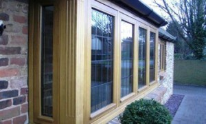 Timber windows - square hardwood bay window with square lead decorative glass