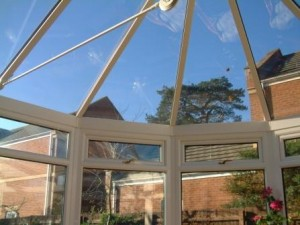 Tinted glass roof in a white PVCu Victorian conservatory