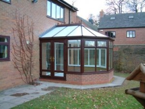 PVCu double doors on a woodgrain effect Victorian conservatory