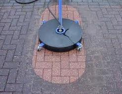 Cleaning and sealing block paving with a rotary washer