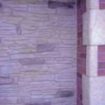 Vertical wall overlay - mountain dry stack with red brick and stone corners