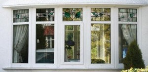 Decorative glass - White PVCu bay window with stained glass
