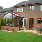 DIY Conservatories - Gable conservatory in woodgrain PVCu outside and white PVCu inside with brickwork detail matching the house