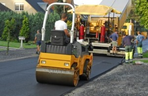 Compacting a newly laid tarmacadam road