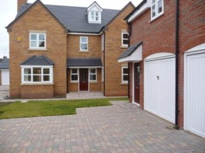 Block paving driveways with tumbled setts