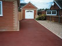 Red tarmacadam driveway
