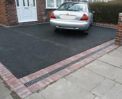 Driveways - Black tarmacadam driveway with block paved edging