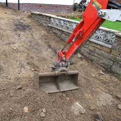 Block paving installation - Excavation of a domestic driveway with a mechanical digger