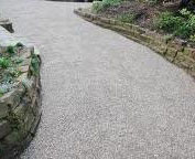 Gravel-driveway-with-stone-retaining-walls