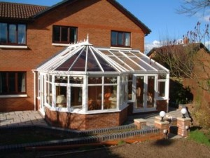 P shape conservatory with paved patio area