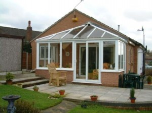 PVCu sliding patio doors - White PVCu Edwardian conservatory with sliding patio doors