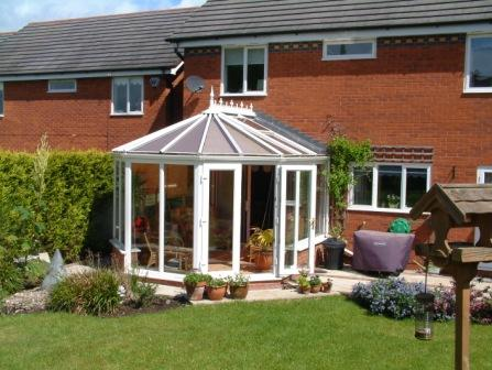 Victorian conservatories - White PVCu Victorian conservatory with double doors on one facet