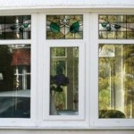 White PVCu bay window with stained glass