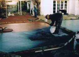 Imprinted concrete installation - applying antique release agent to pattern imprinted concrete