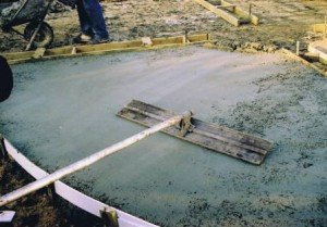 Imprinted concrete installation - concrete being levelled with a screeding tool