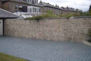 vertical wall overlay and a pattern imprinted concrete driveway